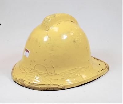 Lot 8-A yellow painted fireman's helmet, size medium,...