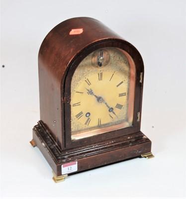 Lot 12-A 1920s mahogany cased dome topped mantel clock...