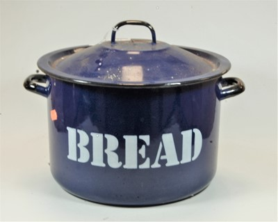 Lot 21-A blue enamelled twin handled bread bin and cover,...
