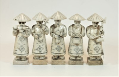 Lot 22-A set of five carved stone figures, each in the...