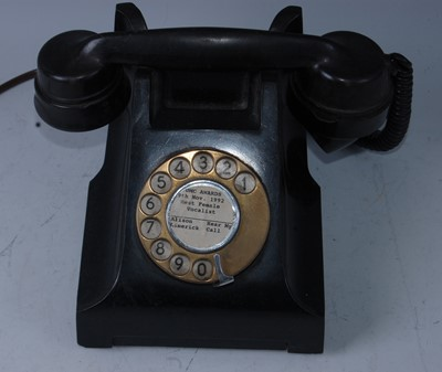 Lot 516-A bakelite telephone, the centre of the dial...