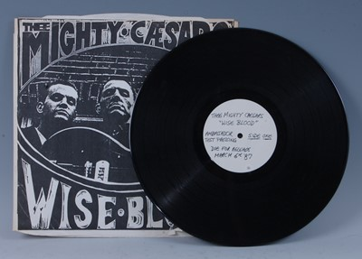 Lot 535-The Mighty Caesars, Wiseblood, 1987 White...