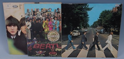 Lot 545-The Beatles, a collection of three LP's to...