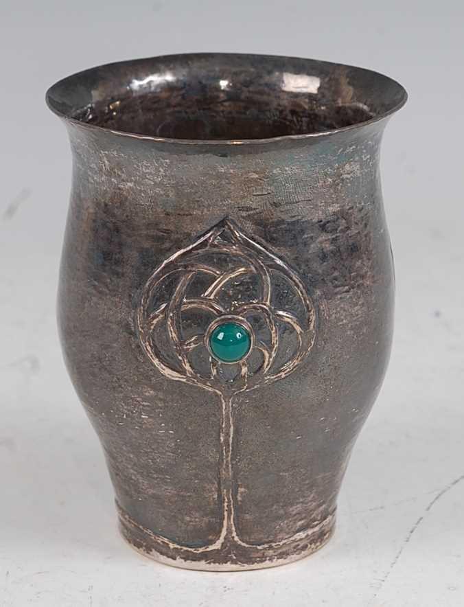 Lot 91 - An Art Nouveau silver hammered beaker, having...