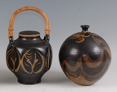 Lot 34-A studio pottery swing handle jar and cover,...