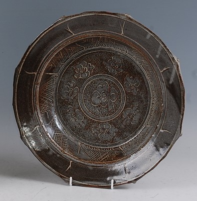 Lot 43-A large studio pottery shallow circular table...