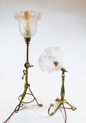 Lot 1-An Edwardian adjustable brass table lamp, the...