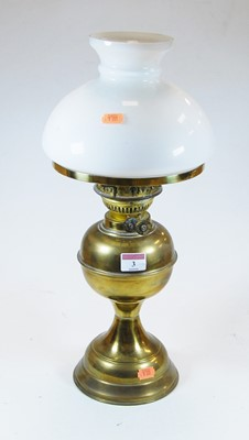 Lot 3-An early 20th century glass oil lamp, the milk...