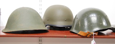 Lot 13-A post-WWII green painted turtle helmet;...