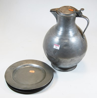 Lot 14-A large pewter water jug, of globular form,...