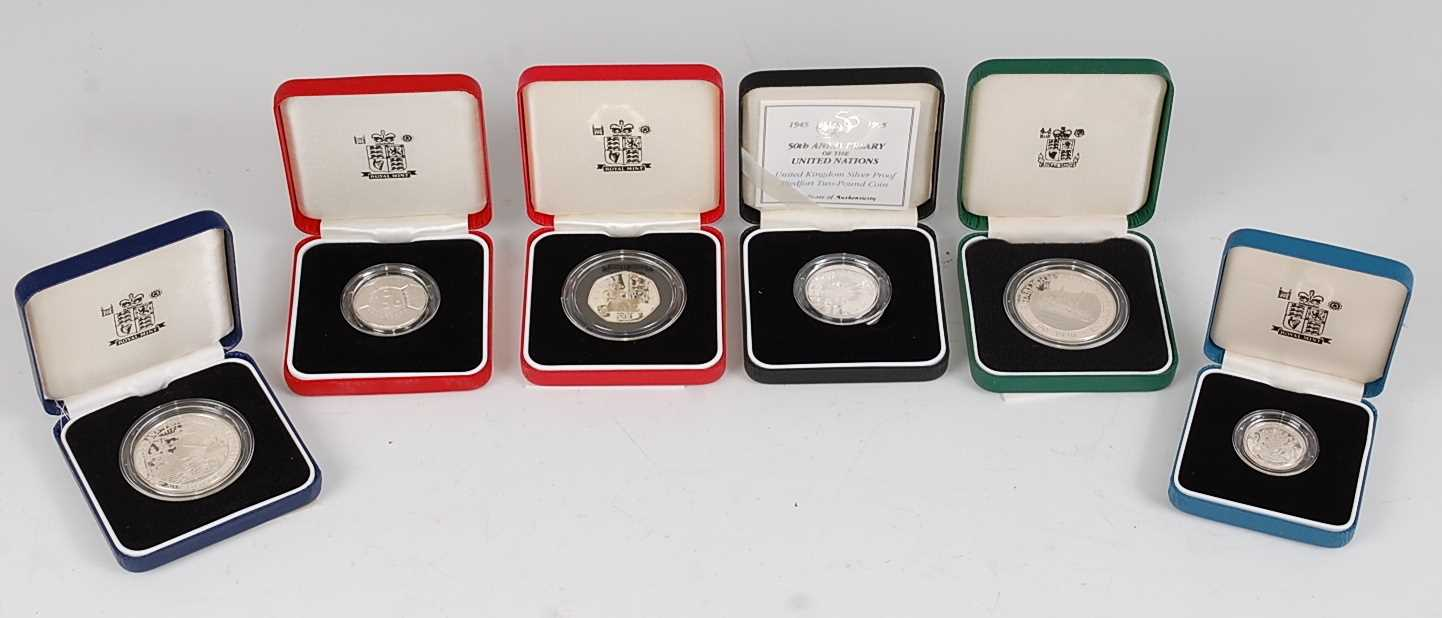 Lot 2009-The Royal Mint, a collection of six silver...