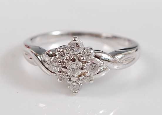 Lot 2513-A white metal diamond marquise shaped cluster...