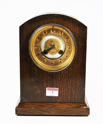 Lot 7-An early 20th century oak cased mantel clock,...