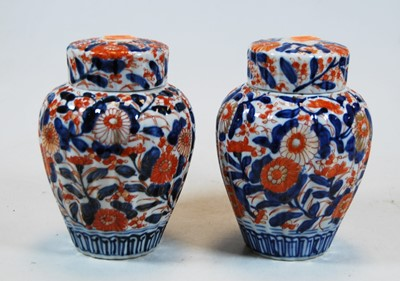 Lot 21-A pair of Chinese imari palette jars and...