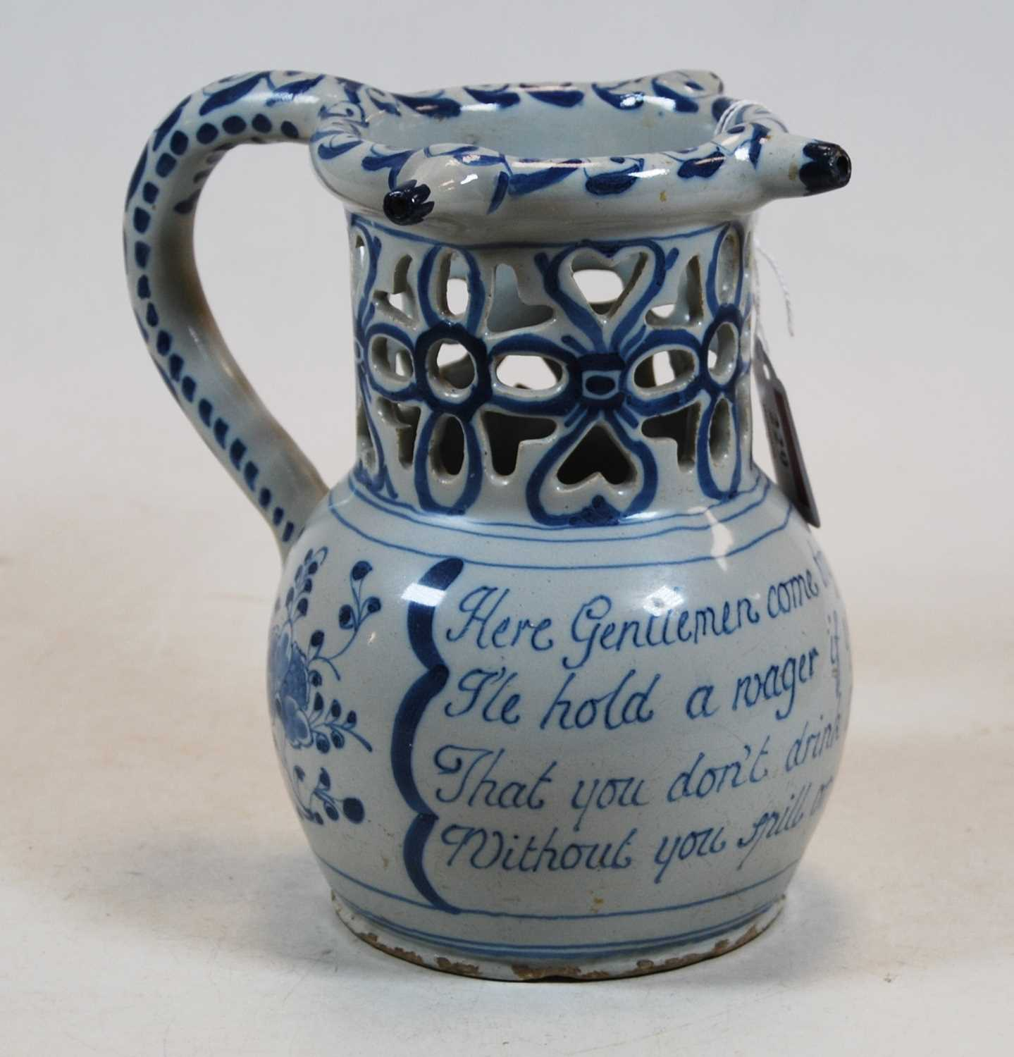 Lot 229 - An 18th century English Delft puzzle jug,...