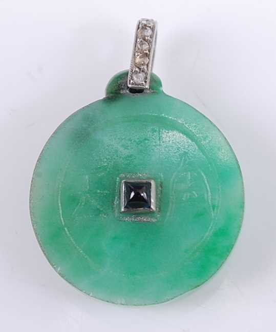 Lot 2563 - An Art Deco jade disc pendant, incised to...