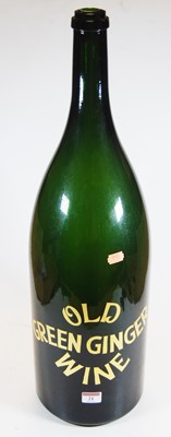 Lot 21-An oversized green glass bottle, inscribed Old...