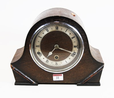Lot 22-A 1930s oak cased mantel clock, the silvered...