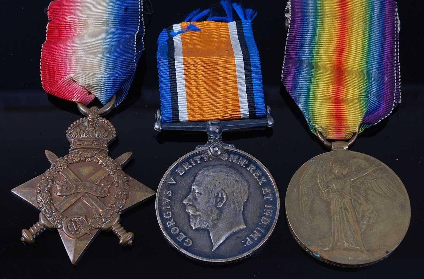 Lot 8-A WW I 1914-15 Star, British War and Victory...