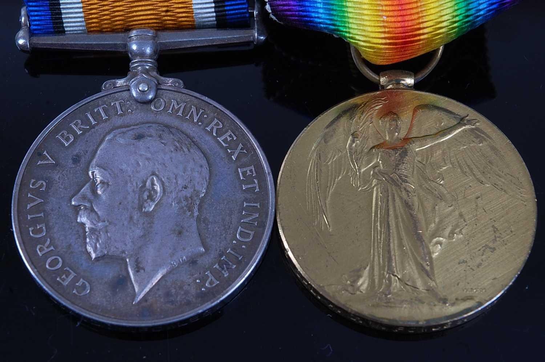 Lot 11-A WW I British War and Victory pair, naming...