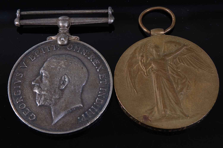 Lot 12-A WW I British War and Victory pair, naming...
