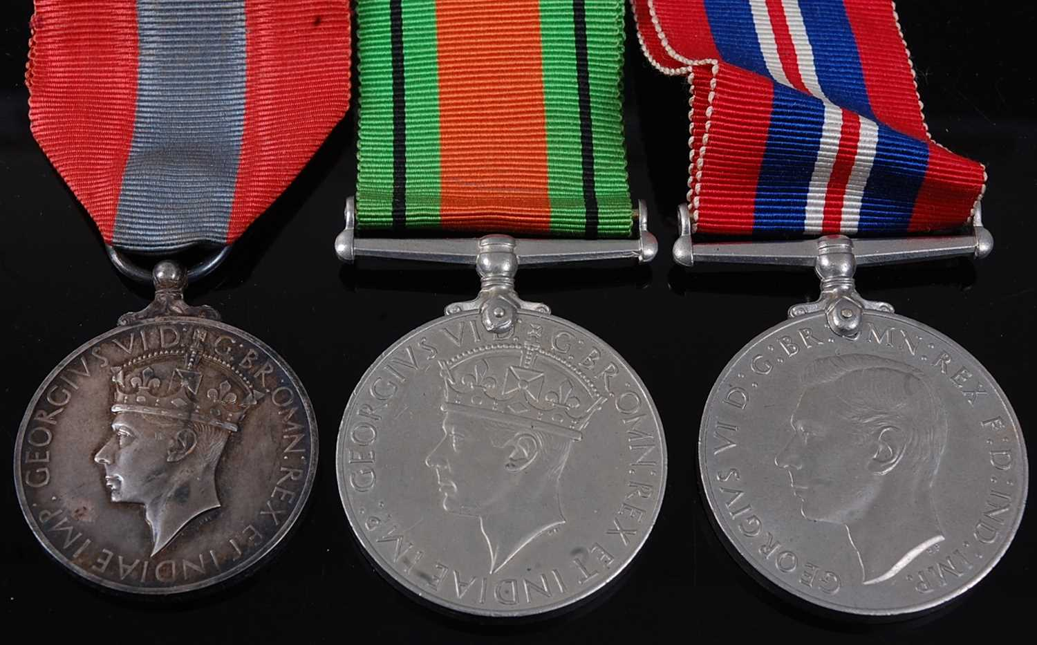 Lot 13-A George VI Imperial Service medal, naming...