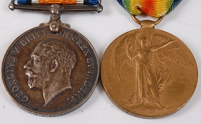Lot 18-A WW I British War and Victory pair, naming...