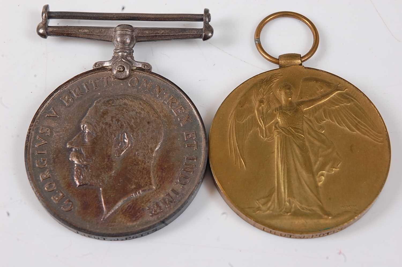 Lot 24-A WW I British War and Victory pair, naming...