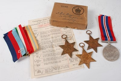 Lot 26-A group of four WW II medals, to include...