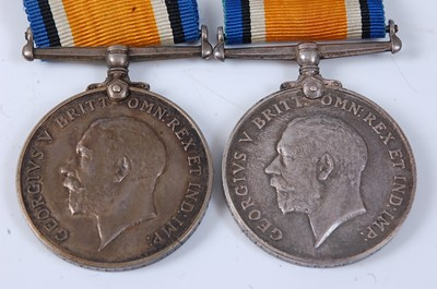 Lot 28-Two WW I British War medals, naming 39774 PTE....