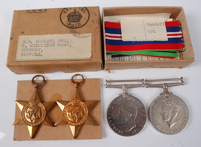 Lot 29-A group of four WW II medals to include...