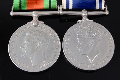 Lot 39-A WW II Defence medal, together with a George...