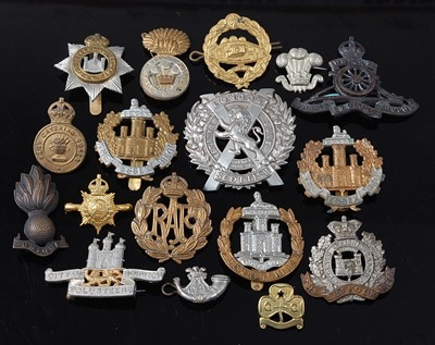 Lot 41-A collection of cap badges and insignia to...
