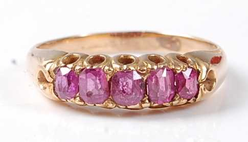 Lot 2505 - A late Victorian yellow metal ruby five-stone...