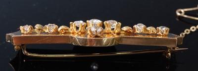 Lot 2553 - A late Victorian yellow metal diamond bar...
