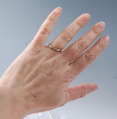 Lot 2508 - A white metal diamond three row curved band,...