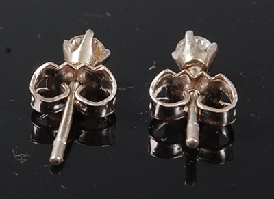 Lot 2511 - A pair of white metal diamond stud earrings,...