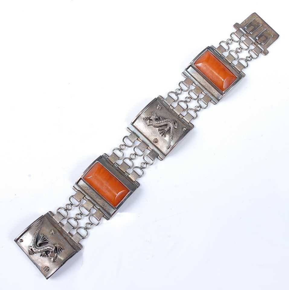 Lot 2512 - A white metal German articulated rectangular...