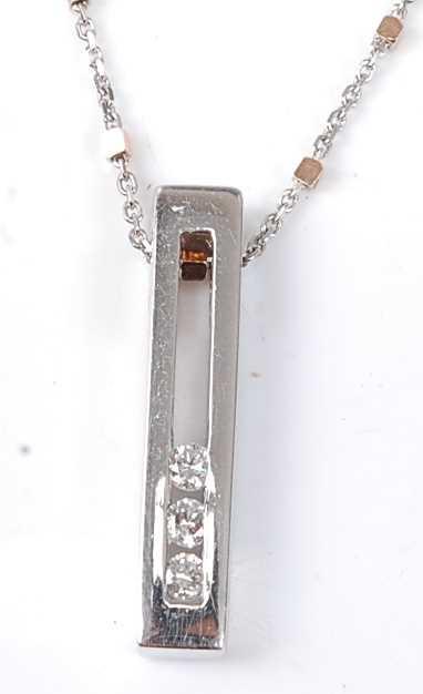 Lot 2515 - A 9ct white gold diamond bar pendant,...