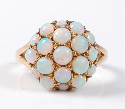 Lot 2509 - A 9ct yellow gold and opal bombe ring,...