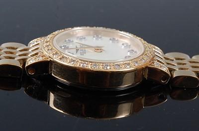 Lot 2518 - A lady's gold plated Eligio diamond set dress...