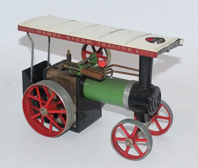 Lot 16 - A Mamod steam tractor, would benefit from...