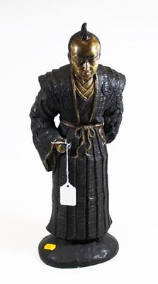 Lot 5 - A hollowcast bronzed metal figure of a...
