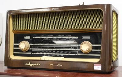 Lot 19 - A 1950s Polish Calypso 62015 radio, housed in...
