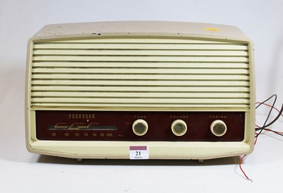 Lot 21 - A 1950s Ferguson radio, housed in a beige...