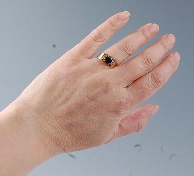 Lot 2520 - A yellow metal, sapphire and diamond dress...