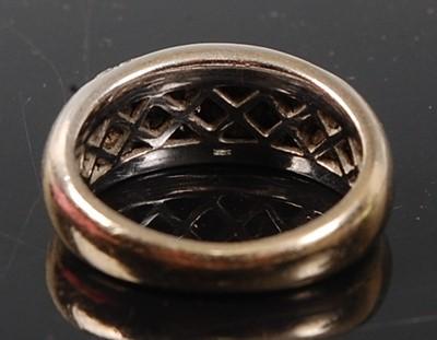 Lot 2528 - An 18ct white gold five-row diamond half hoop...