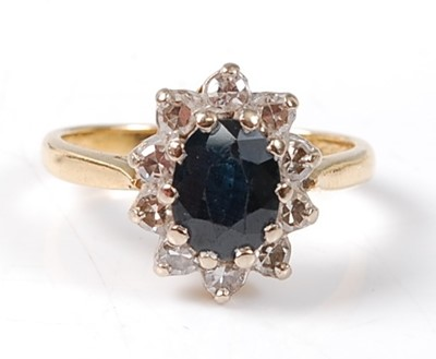 Lot 2530 - An 18ct yellow and white gold, sapphire and...