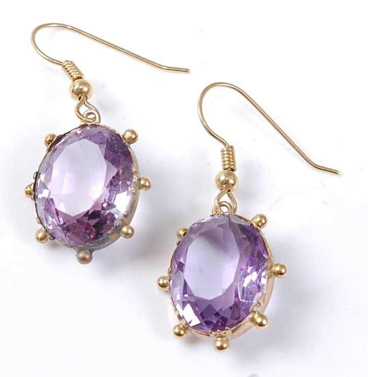 Lot 2534 - A pair of yellow metal oval amethyst drop...