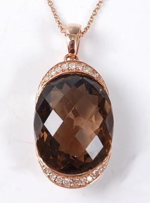 Lot 2525 - A rose metal, smoky quartz and diamond pendant,...